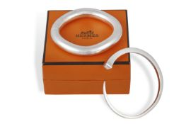 TWO SILVER BRACELETS, BY HERMÈS A polished 925 silver torque bangle of square tapering form with