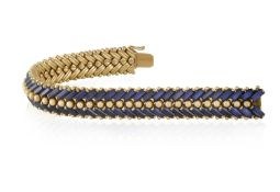 A SAPPHIRE BRACELET, BY ILLARIO, CIRCA 1955 The supple and articulated bracelet composed of two rows
