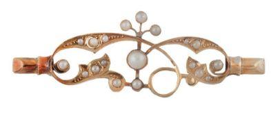Broche de pp. S. XX con perlas de cristal en líneas de ramas entrelazas