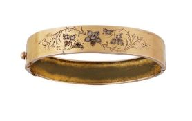 Brazalete rígido S. XIX con flores de diamantes en aro liso de metal dorado