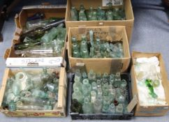 A collection of assorted glass bottles & stoneware jars.