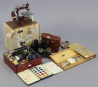 An Essex miniature sewing machine, boxed; together with two paint sets; ten various die-cast scale