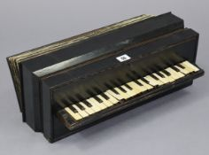 "An early /mid-20th century Busson of Paris ebonised wooden accordion, 18¼"" long."