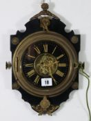 A French wall clock with skeleton movement, & in ebonised wooden case with gilt metal mounts, 13½""