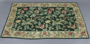 "An Aubusson-type rug of green ground & with all-over multi-coloured foliate design, 63"" x 39"";"