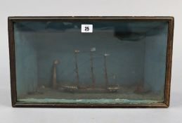 An early-mid 20th century diorama depicting three boats with lighthouse to the background, in wooden