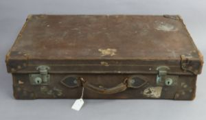 An early-mid 20th century fibre-covered & leather-bound suitcase, with chrome twin-lever locks, 26½""