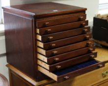 "A mahogany coin collector's cabinet fitted nine long drawers with block handles, 18½"" wide x 18½"""