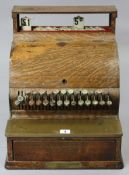 AN EARLY 20th CENTURY NATIONAL CASH REGISTER (MODEL No. 743), in grained tin & oak case (slight