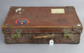 "An early-mid20th century tan leather suitcase, fitted brass twin-lever locks, 24"" wide."