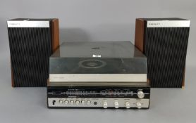 "A solid state turntable with speakers; & a Samsung ""Hi 8"" 8mm camcorder with various accessories."