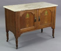 An Edwardian oak marble-top washstand enclosed by pair of panel doors with painted Arts & Crafts sty