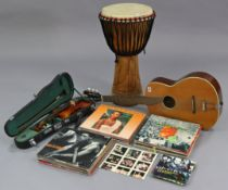 A Skylark child's violin & bow, cased; a six-string acoustic guitar; a drum; & approximately