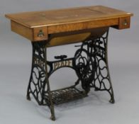 "An early 20th century Pfaff treadle sewing machine in oak case, & on cast-iron stand, 37"" wide."