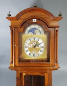 A reproduction West German longcase clock with moon phase dial, & in mahogany – finish case, 81""