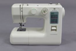 A Janome electric sewing machine with case, w.o.