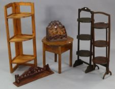 Two Edwardian folding cake stands; together with an oak needlework table; a pine fold-away corner