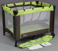 A Bable travel cot/playpen, with case.