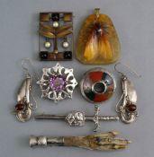 "An Almeric Walter pâte-de-verre triangular pendant depicting a moth, 1¾"" high (w.a.f.); a bronzed"