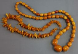 A butterscotch amber necklace of graduated oval beads (53 gm); & a similar necklace of