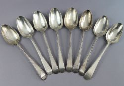 Eight George III silver Old English Bead pattern table spoons; London 1777 by Thos. Northcote, two