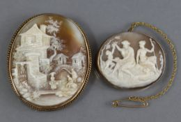 A late 19th/early 20th century carved shell oval cameo brooch depicting a classical figure scene, in