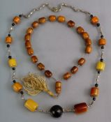 Two amber bead necklaces.