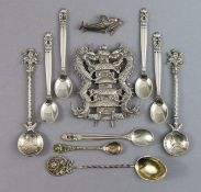 Five Georg Jensen .835 standard coffee spoons with stylised floral terminals, circa 1915-30; a Georg