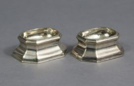 A PAIR OF GEORGE I SILVER TRENCHER SALT CELLARS of elongated octagonal form, each with oval