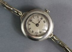 An early 20th century ladies' wristwatch, the small silvered circular dial with black roman