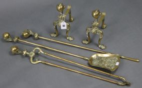 """A pair of ornate cast brass fire-dogs with claw-&-ball terminals, 9½"""" high & a ditto set of three"""