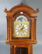 """A reproduction West German longcase clock with moon phase dial, & in mahogany–finish case, 81"""""""