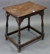 A late 19th/early 20th century oak occasional table with carved decoration to the rectangular top, &