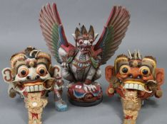 """A Balinese painted & carved wooden winged lion Hannoman figure, 21½"""" high; a similar smaller"""