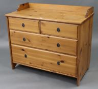 """A pine low tray-top chest fitted two short & two long graduated drawers, 37¼"""" wide x 32½"""" high."""