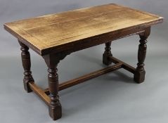 A GOOD QUALITY REPRODUCTION OAK DRAW-LEAF DINING TABLE on four turned legs with plain stretchers,