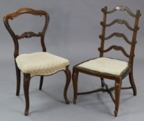 A Victorian rosewood dining chair with kidney-shaped back, padded seat, & on slender carved cabriole