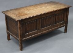 """An oak coffer with hinged lift-lid, linen-fold panel front, & on short square legs, 42"""" wide x 20"""""""