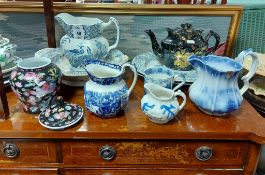 """A collection of eight Victorian copper lustre jugs; a Mason's Ironstone china """"Mandalay"""" pattern"""