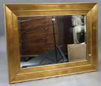 "A large gilt frame rectangular wall mirror inset bevelled plate, 35½"" x 47½""."