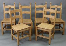 A set of six hardwood rail-back dining chairs with hard seats, & on square legs with plain