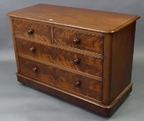 A Victorian figured mahogany low chest fitted two short & two long graduated drawers with turned