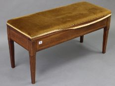 """An Edwardian inlaid mahogany """"duet"""" piano stool with padded hinged seat, & on four square tapered"""