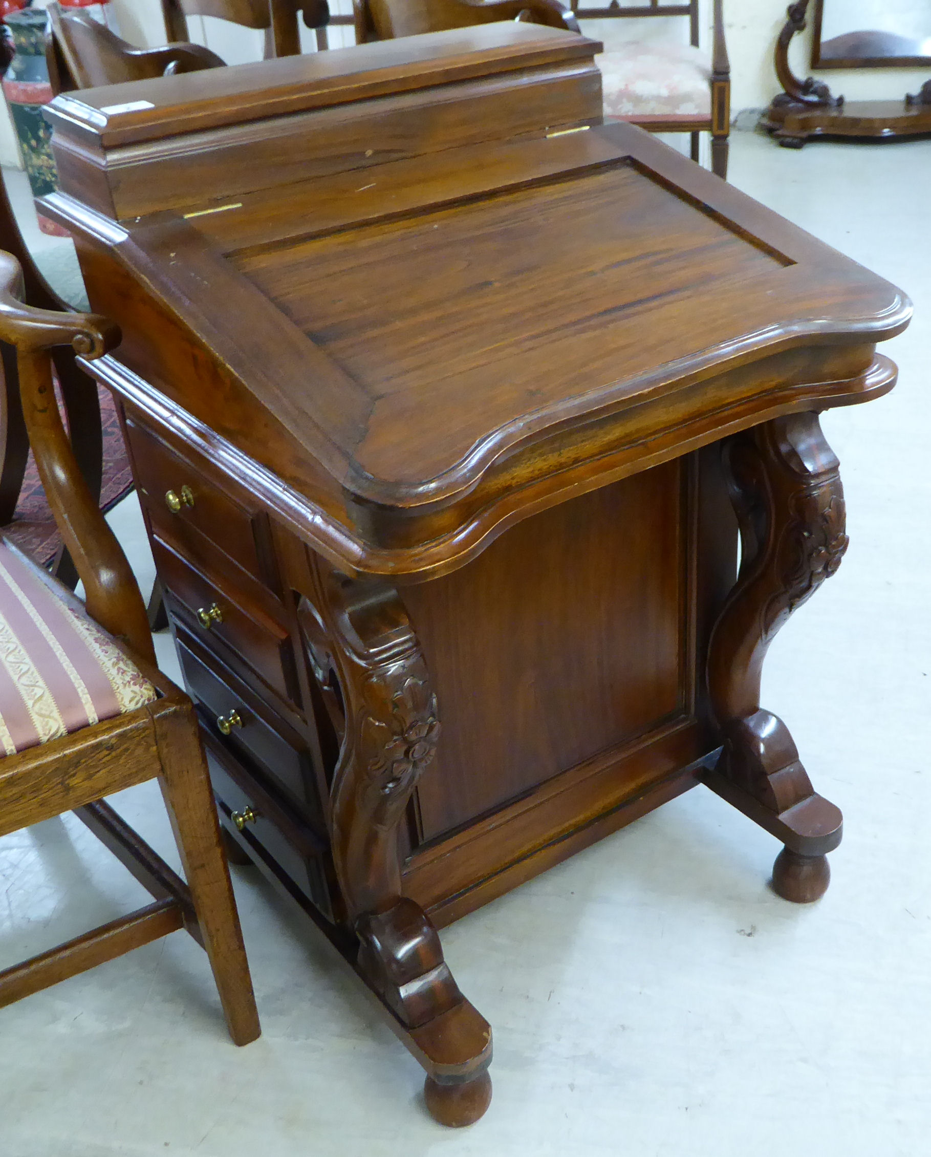 Lot 2 - A modern reproduction of a Victorian mahogany Davenport with a hinged top,
