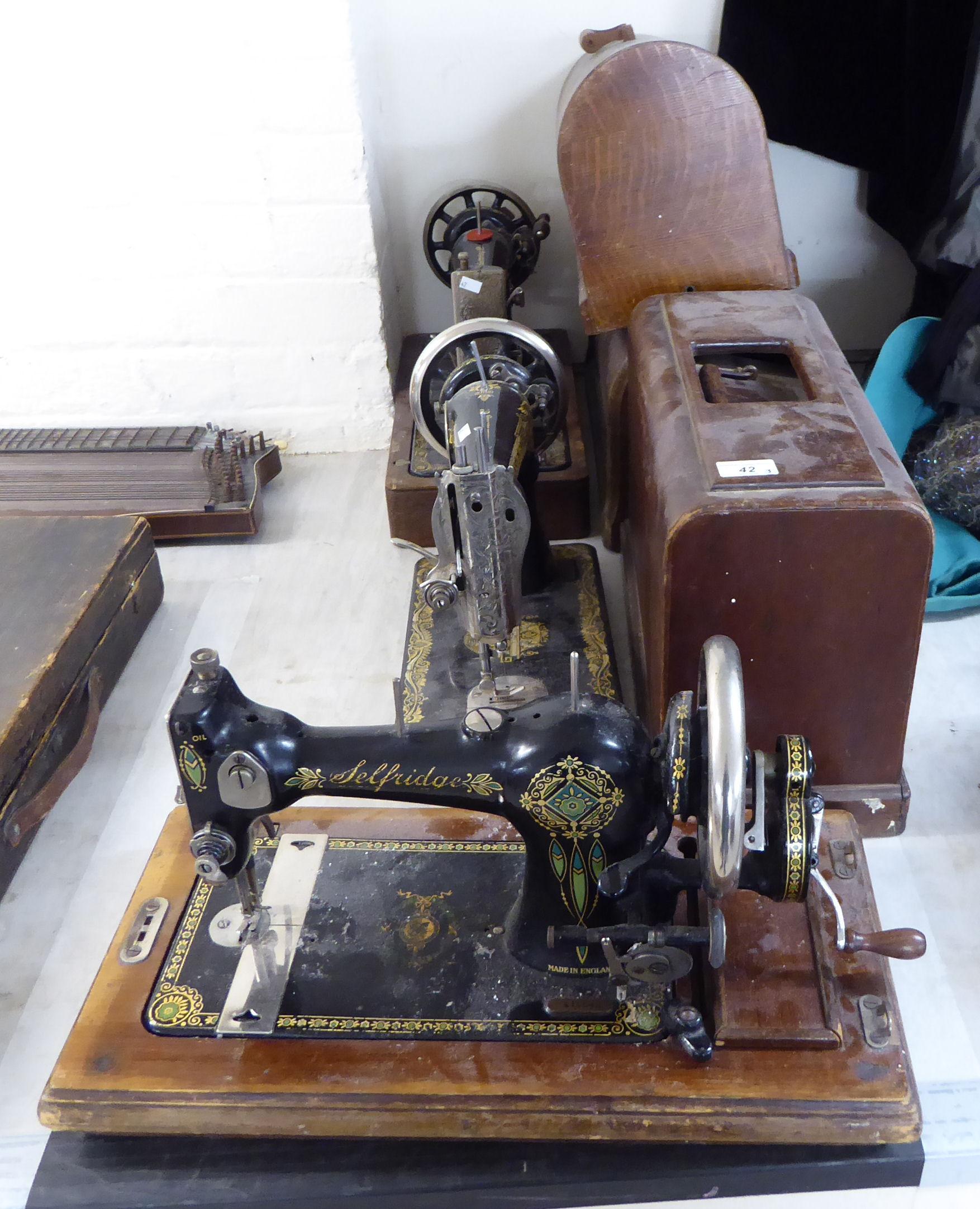 Lot 42 - Two similar manual Singer sewing machines, model no.