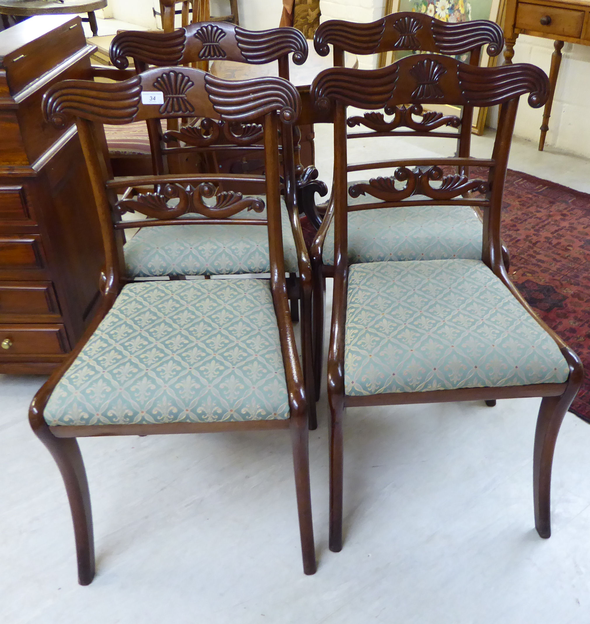 Lot 34 - A set of four William IV mahogany framed bar back dining chair, the later,