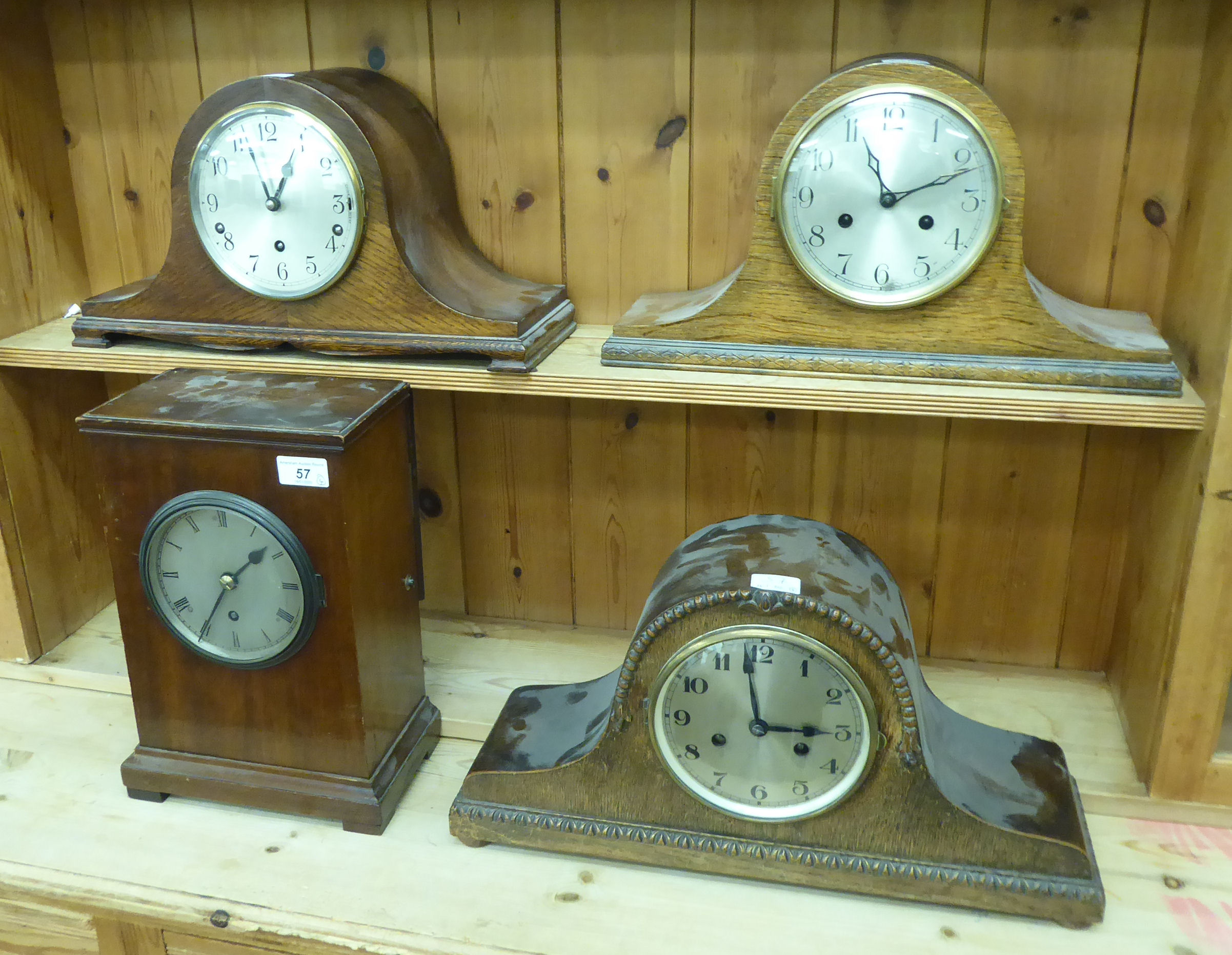 Lot 57 - Four early 20thC mantle clocks: to include a mahogany cased example,