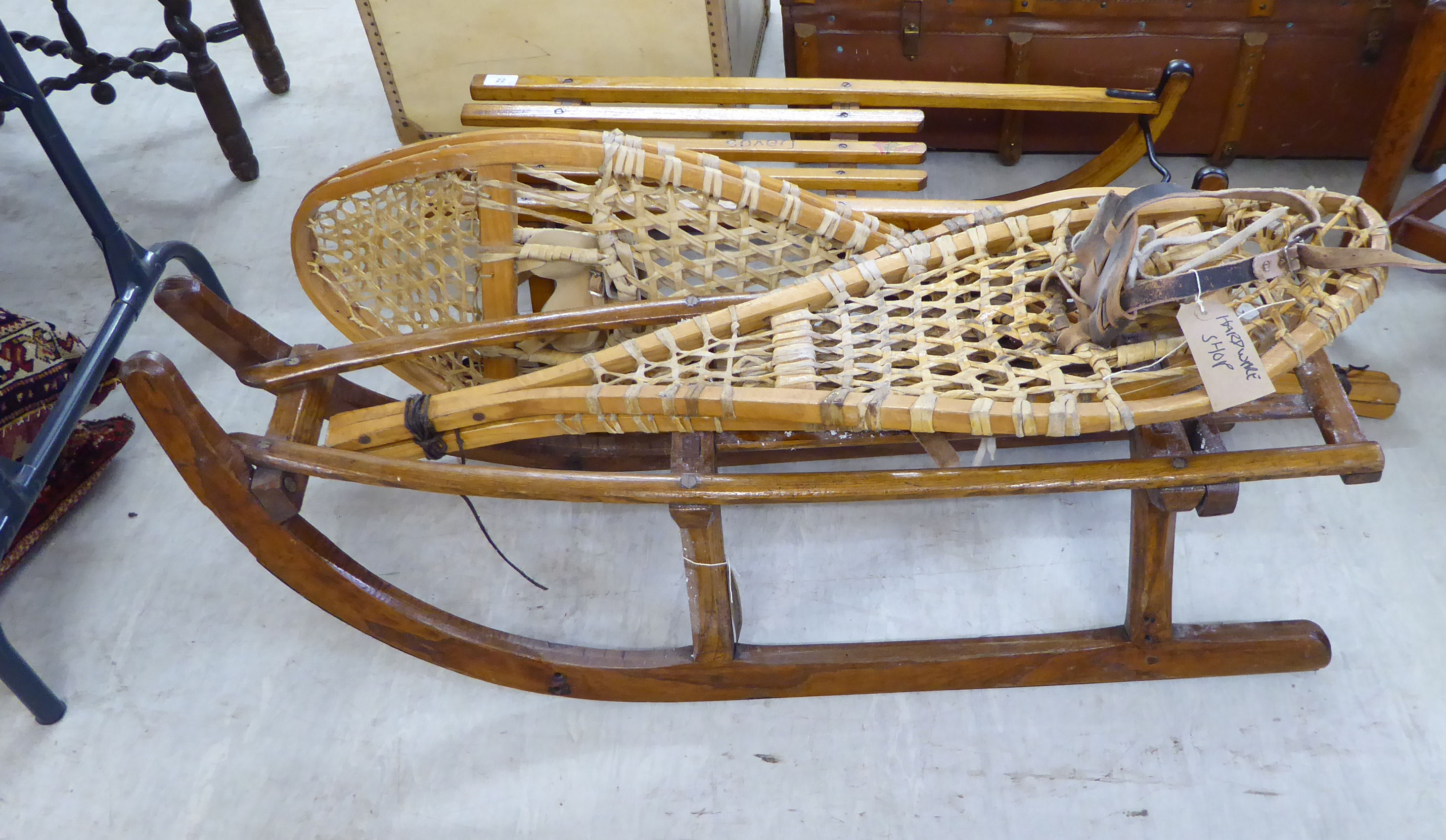 Lot 22 - Two similar early 20thC lacquered oak sledges;