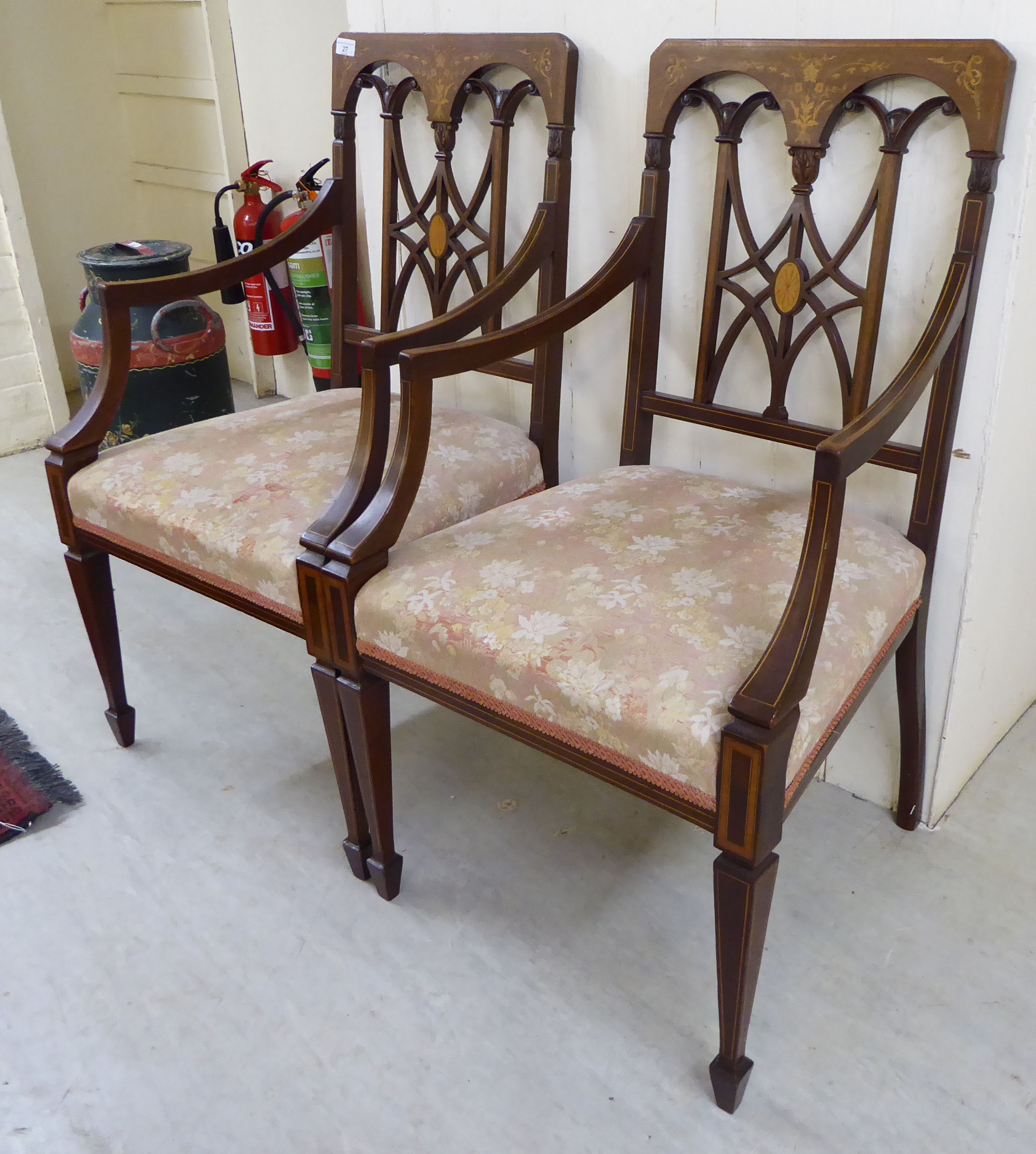 Lot 27 - A pair of Edwardian string and marquetry inlaid mahogany framed open arm chairs,
