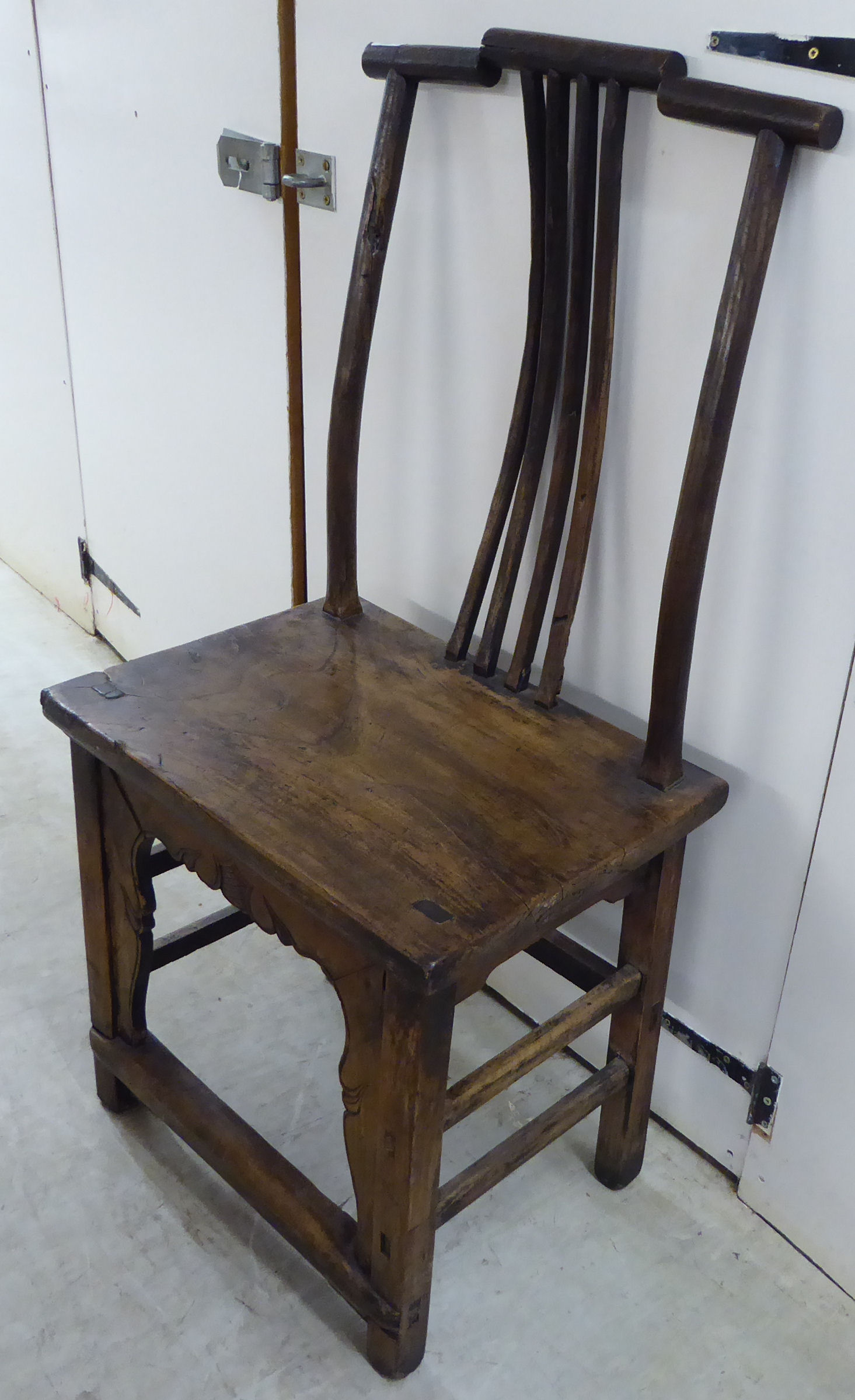 Lot 35 - A Chinese elm framed official's hat chair with a solid seat and block, cut-out front,